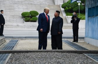 North Korea's leader Kim Jong Un talks with US President Donald Trump as they stand north of the Military Demarcation Line that divides North and South Korea, in the Joint Security Area (JSA) of Panmunjom in the Demilitarized zone (DMZ) on June 30, 2019. (Photo by Brendan Smialowski / AFP)
