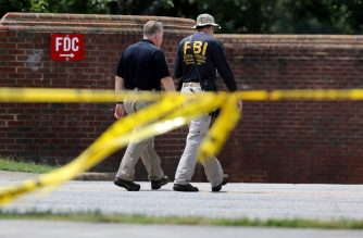VIRGINIA BEACH, VIRGINIA - JUNE 02: Federal Bureau of Investigation agents continue to process the crime scene following a mass shooting at the City of Virginia Beach Operations Building June 02, 2019 in Virginia Beach, Virginia. Eleven city employees and one private contractor were shot to death Friday in the operations building by engineer DeWayne Craddock who had worked for the city for 15 years.   Chip Somodevilla/Getty Images/AFP