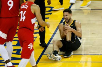 OAKLAND, CALIFORNIA - JUNE 13: Klay Thompson #11 of the Golden State Warriors reacts after hurting his leg against the Toronto Raptors in the second half during Game Six of the 2019 NBA Finals at ORACLE Arena on June 13, 2019 in Oakland, California. NOTE TO USER: User expressly acknowledges and agrees that, by downloading and or using this photograph, User is consenting to the terms and conditions of the Getty Images License Agreement.   Lachlan Cunningham/Getty Images/AFP