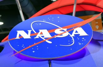 FILES: LAS VEGAS, NV - JANUARY 11: The NASA logo is displayed at the agency's booth during CES 2018 at the Las Vegas Convention Center on January 11, 2018 in Las Vegas, Nevada. CES, the world's largest annual consumer technology trade show, runs through January 12 and features about 3,900 exhibitors showing off their latest products and services to more than 170,000 attendees.   Ethan Miller/Getty Images/AFP
