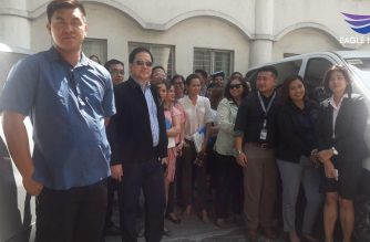 Justice Secretary Menardo Guevarra poses for a picture with DOJ employees during the earthquake drill at the DOJ office in Manila on Thursday, June 20./Moira Encina/Eagle News/
