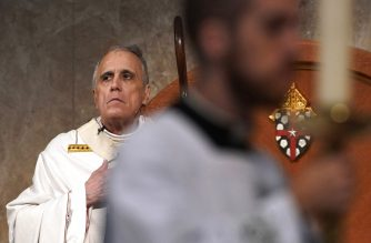 Cardinal Daniel DiNardo presides over a Mass of Ordination for candidates for the priesthood at the Co-Cathedral of the Sacred Heart in Houston Saturday, June 1, 2019. DiNardo, leading the U.S. Catholic Church's sex abuse response, has been accused of mishandling a case where his deputy allegedly manipulated a woman into a sexual relationship, even as he counselled her husband and solicited their donations. The Galveston-Houston archdiocese acknowledged a sexual relationship between Monsignor Frank Rossi and parishioner Laura Pontikes, but asserted that it was consensual. (AP Photo/David J. Phillip)