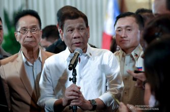 "President Rodrigo Roa Duterte answers queries from members of the media following the oath taking ceremony of Senator Christopher Lawrence ""Bong"" Go at the Malacañan Palace on June 27, 2019. Also in the photo is Presidential Chief Legal Counsel and Spokesperson Salvador Panelo. ROBINSON NIÑAL JR./PRESIDENTIAL PHOTO"