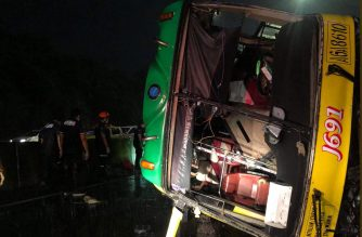 The bus that turned on its side at NLEX on Friday night, June 28, 2019.  At least six people were reported killed while a still undetermined number of passengers were injured.  (Photo courtesy Philippine Red Cross.