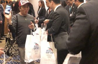 """OFW guest William """"Obing"""" Quirante waves happily after he received his share of the giveaways. (Photo by Fleurdeliz Amora and Christine Mendoza; EBC Japan Bureau)"""
