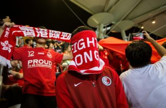 Hong Kong football fans have a history of covering their faces or booing during the Chinese national anthem. (Agence France Presse)