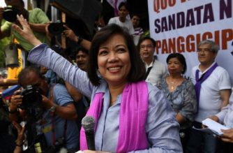 Ousted Philippine Supreme Court Chief Justice Maria Lourdes Sereno waves to supporters in front of the supreme court building in Manila on May 11, 2018. - Judges of the Philippines' top court voted on May 11 to remove their chief justice, who faced ouster efforts after battling with President Rodrigo Duterte over his deadly war on drugs. (Photo by TED ALJIBE / AFP)