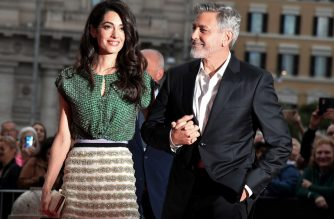 "US actor George Clooney (R) and wife British-Lebanese Amal Clooney arrive to the premiere of ""Catch-22""  on May 13, 2019 in Rome (Photo by Tiziana FABI / AFP)"