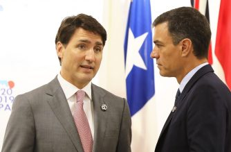 "Canada's Prime Minister Justin Trudeau (L) talks to Spain's Prime Minister Pedro Sanchez at an event on the theme ""Promoting the place of women at work"" on the sidelines of the G20 Summit in Osaka on June 29, 2019. (Photo by Dominique JACOVIDES / POOL / AFP)"