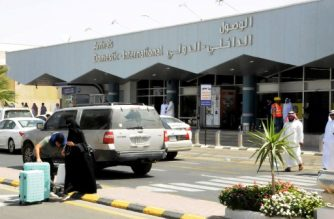 """Travellers gather in front of the arrivals lounge at the Abha airport in the southern Saudi Arabian popular mountain resort of the same name, on July 2, 2019. - A Yemeni rebel attack on the civilian airport wounded nine civilians today, a Riyadh-led coalition said, the latest in a series of strikes on the site. (Photo by - / AFP) / """"The erroneous mention[s] appearing in the date of this series of photos by - has been modified in AFP systems in the following manner: [July 2, 2019] instead of [June 2, 2019]. Please immediately remove the erroneous mention[s] from all your online services and delete it (them) from your servers. If you have been authorized by AFP to distribute it (them) to third parties, please ensure that the same actions are carried out by them. Failure to promptly comply with these instructions will entail liability on your part for any continued or post notification usage. Therefore we thank you very much for all your attention and prompt action. We are sorry for the inconvenience this notification may cause and remain at your disposal for any further information you may require."""""""