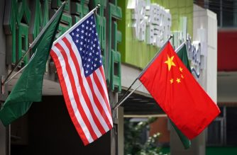 (FILES) This file photo taken on May 14, 2019 shows the US (L) and Chinese flags displayed outside a hotel in Beijing. - Caught in the crossfire of the US-China trade war, Chinese students are looking for alternative study destinations -- threatening to turn off an important source of revenue for US universities. (Photo by Greg Baker / AFP) / TO GO WITH China-US-trade-education, FOCUS BY Poornima WEERASEKARA
