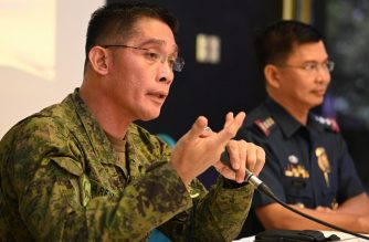 "Philippine Armed Forces spokesperson Brigadier General Edgard Arevalo (L) speaks beside Philippine National Police (PNP) spokesperson Bernard Banac during a joint press conference at the military headquarters in Manila on July 10, 2019. - Philippine security forces confirmed on July 10 that at least one Filipino ""suicide bomber"" was behind a deadly attack last month, in a first for the Asian country. (Photo by Ted ALJIBE / AFP)"