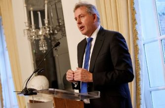 """(FILES) In this file photo taken on January 18, 2017 British Ambassador Kim Darroch speaks at an Afternoon Tea hosted by the British Embassy to mark the U.S. Presidential Inauguration at The British Embassy in Washington, DC. - Britain's ambassador to Washington Kim Darroch said on July 10, 2019, he was resigning after drawing US President Donald Trump's ire for criticising his administration in leaked confidential cables to London. """"The current situation is making it impossible for me to carry out my role as I would like,"""" Darroch wrote in his resignation letter. """"I believe in the current circumstances the responsible course is to allow the appointment of a new ambassador."""" (Photo by Paul Morigi / GETTY IMAGES NORTH AMERICA / AFP)"""