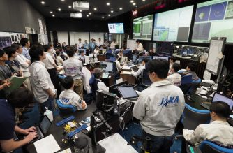 "This handout photograph taken and released by the Institute of Space and Astronautical Science (ISAS) of Japan Aerospace Exploration Agency (JAXA) on July 11, 2019 shows researchers and employees holding a briefing at the Hayabusa2 mission control room in Sagamihara city, Kanagawa prefecture. - Japan's Hayabusa2 probe neared a distant asteroid on July 11 as it descended for a final touchdown, hoping to collect samples that could shed light on the evolution of the solar system. (Photo by Yutaka IIJIMA / ISAS-JAXA / AFP) / RESTRICTED TO EDITORIAL USE - MANDATORY CREDIT ""AFP PHOTO / ISAS-JAXA"" - NO MARKETING NO ADVERTISING CAMPAIGNS - DISTRIBUTED AS A SERVICE TO CLIENTS"
