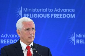 "US Vice President Mike Pence speaks during the second Ministerial to Advance Religious Freedom in the Loy Henderson Auditorium of the State Department in Washington, DC, on July 18, 2019. - Pence said Thursday that the US is imposing sanctions on the leaders of two Iranian-linked militia groups in Iraq. ""Let me be clear, the United States will not stand idly while Iranian-backed militias spread terror,"" Pence told the high-level meeting on religious freedom, without naming the individuals targeted. (Photo by MANDEL NGAN / AFP)"