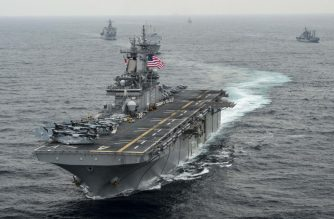 "(FILES) This US Navy file photo taken on March 7, 2016  shows the amphibious assault ship USS Boxer (LHD 4) as it transits the East Sea during Exercise Ssang Yong 2016. - The US military shot down an Iranian drone on July 18, 2019 that came within 1,000 yards of one of its naval vessels in the Strait of Hormuz, President Donald Trump said.""The (USS) Boxer took defensive action against an Iranian drone which had closed into a very, very near distance, approximately 1,000 yards,"" Trump announced at the White House. (Photo by Craig Z. Rodarte / US NAVY / AFP) / RESTRICTED TO EDITORIAL USE - MANDATORY CREDIT ""AFP PHOTO /US NAVY/Greg Z. RODARTE/HANDOUT"" - NO MARKETING NO ADVERTISING CAMPAIGNS - DISTRIBUTED AS A SERVICE TO CLIENTS"