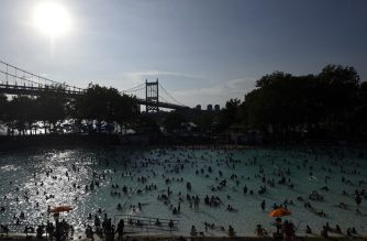People enjoy the Astoria Pool on a hot afternoon in the borough of Queens, New York City, on July 20, 2019. - The US is sweating through a weekend of extremely hot weather, with major cities including New York and Washington bracing for temperatures close to or exceeding 100 degrees Fahrenheit (38 degrees Celsius). Nearly 150 million people across the country are facing hazardous temperatures in a heatwave stretching from the Midwestern plains to the Atlantic coast, the National Weather Service said. (Photo by Johannes EISELE / AFP)