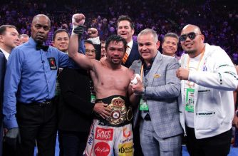 Filipino boxer Manny Pacquiao (C) celebrates after defeating US boxer Keith Thurman during their WBA super world welterweight title fight at the MGM Grand Garden Arena on July 20, 2019 in Las Vegas, Nevada. - Pacquiao won a 12 round split decision. (Photo by John Gurzinski / AFP)