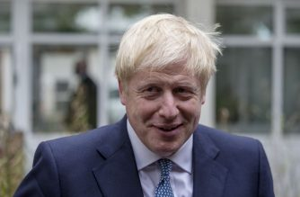 Britain's Prime Minister Boris Johnson gestures as he meets graduates of West Midlands Police training centre in Birmingham, central England on July 26, 2019. - Johnson pledged to start recruiting 20,000 new police officers as one of a number of anouncements on his government's domestic policy agenda during his debut statement in the House of Commons as Prime Minister on July 25. (Photo by Jack Hill / POOL / AFP)