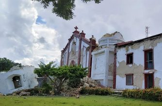 """This handout picture taken and received on July 27, 2019 courtesy of Dominic De Sagon Asa shows the damage to the Sta Maria de Mayan Church after a pair of strong earthquakes of magnitude 5.4 and 5.9 struck the region within hours of each other, in Itbayat on Batanes island. - Eight people were killed and dozens injured when the twin earthquakes struck islands in the northern Philippines early on July 27 while many were still asleep, local officials said. (Photo by Dominic DE SAGON ASA / Courtesy of Dominic DE SAGON ASA / AFP) / -----EDITORS NOTE --- RESTRICTED TO EDITORIAL USE - MANDATORY CREDIT """"AFP PHOTO / Courtesy of Dominic DE SAGON ASA"""" - NO MARKETING - NO ADVERTISING CAMPAIGNS - DISTRIBUTED AS A SERVICE TO CLIENTS - NO ARCHIVES"""