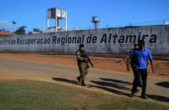 A police officer patrols the surroundings of the Altamira Regional Recovery Centre after t least 52 inmates were killed in a prison riot, in the Brazilian northern city of Altamira, Para State, on July 29, 2019. - At least 52 inmates were killed in a prison riot as rival gang factions fought each other, an official said. Sixteen of the dead were decapitated in the second major eruption of violence to rock the country's severely overpopulated and deadly prison system in as many months. Two guards were taken hostage during the hours-long clashes, which were brought under control at around midday. They were eventually freed. (Photo by Bruno SANTOS / AFP)