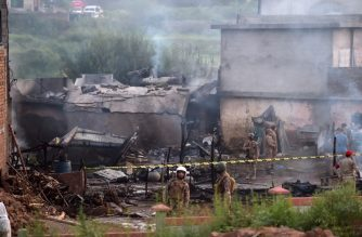 Military personnel work at the scene where a Pakistani Army Aviation Corps aircraft crashed in Rawalpindi on July 30, 2019. - Fifteen people were killed when a small plane crashed into a residential area in the Pakistani city of Rawalpindi near the capital Islamabad, a rescue official told AFP early July 30. (Photo by AAMIR QURESHI / AFP)
