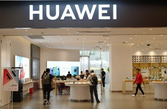 (FILES) This file photo taken on May 22, 2019 shows people browsing for items in a Huawei store in a shopping mall in Shanghai. - Huawei's revenue jumped by 23 percent in the first half of the year, the company said on July 30, 2019, as the Chinese telecom giant shrugged off US sanctions. (Photo by Hector RETAMAL / AFP)