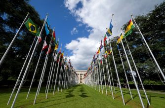 A picture taken on June 6, 2017 shows the flags avenue at the United Nations (UN) offices in Geneva. (Photo by Fabrice COFFRINI / AFP)