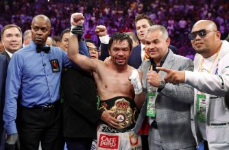LAS VEGAS, NEVADA - JULY 20: Manny Pacquiao (C) poses with members of his team and referee Kenny Bayless after defeating Keith Thurman by split decision in a WBA welterweight title fight at MGM Grand Garden Arena on July 20, 2019 in Las Vegas, Nevada.   Steve Marcus/Getty Images/AFP