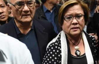 (File photo) Former Senate Sgt-at-arms, retired major general Jose Balajadia, is seen here escorting Senator Leila De Lima as she walks to a press conference in the senate in Manila on February 23, 2017, as she awaits the warrant of arrest to be served. (Image cropped from AFP PHOTO / TED ALJIBE)