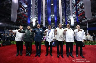 """President Rodrigo Duterte strikes his signature pose with Senator Ronald dela Rosa, Armed Forces of the Philippines Chief of Staff General Benjamin Madrigal Jr., Philippine Air Force (PAF) Commander Lieutenant General Rozzano Briguez, Defense Secretary Delfin Lorenzana, National Security Adviser Hermogenes Esperon Jr., and Senator Christopher Lawrence """"Bong"""" Go during the 72nd PAF Anniversary at the Col. Jesus Villamor Air Base in Pasay City on July 2, 2019. KARL NORMAN ALONZO/PRESIDENTIAL PHOTO"""