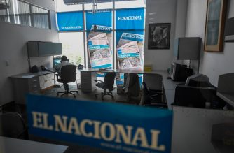 (FILES) In this file photo taken on June 14, 2019, an employee works at a room of Venezuelan newspaper El Nacional in Caracas. Due to the shortage of paper and scarce personnel, the Venezuelan press was pushed to internet as a way to survive in a country with precarious connectivity. (Photo by Federico PARRA / AFP)