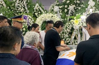 President Rodrigo Duterte on Saturday, July 20, visited the wake of four policemen who were reportedly killed by NPA rebels in Negros Oriental./PNP/