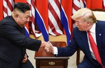 (FILE) North Korea's leader Kim Jong Un (L) and US President Donald Trump shake hands during a meeting on the south side of the Military Demarcation Line that divides North and South Korea, in the Joint Security Area (JSA) of Panmunjom in the Demilitarized zone (DMZ) on June 30, 2019. (Photo by Brendan Smialowski / AFP)