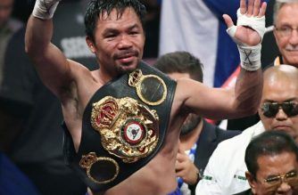 LAS VEGAS, NEVADA - JULY 20: Manny Pacquiao celebrates his split-decision victory over Keith Thurman in their WBA welterweight title fight at MGM Grand Garden Arena on July 20, 2019 in Las Vegas, Nevada.   Cropped photo of Ethan Miller/Getty Images/AFP