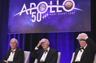 Apollo 11 astronaut Michael Collins (C) and Apollo 9 astronaut Rusty Schweikart (R) shade their eyes, while Apollo 16 astronaut Charlie Duke looks on, while taking a question from a reporter during the 'Legends of Apollo' media in Cocoa Beach, Florida on July 16, 2019, as NASA celebrates the 50th Anniversary of the landing on the Moon. (Photo by Gregg Newton / AFP)