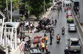 Onlookers and the police gather at the scene of an explosion in Bangkok on August 2, 2019. (Photo by Lillian SUWANRUMPHA / AFP)