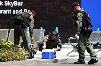 Members of the explosive ordinance disposal unit gather at the scene of an explosion in Bangkok on August 2, 2019. (Photo by Lillian SUWANRUMPHA / AFP)