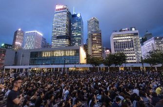 People attend a protest held by medics in the Central District of Hong Kong on August 2, 2019, in the latest opposition to a planned extradition law that was quickly evolved into a wider movement for democratic reforms. - Hong Kong civil servants on August 2 night kicked off a weekend of anti-government protests and unsanctioned rallies in defiance of warnings from China and after a prominent independence campaigner was arrested. (Photo by Laurel Chor / AFP)