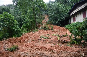 A general view shows a landslide in Kalaw village in Bilugyun township, Mon State on August 10, 2019. - At least 22 people were killed when a landslide triggered by monsoon rains struck a village in eastern Myanmar, as emergency workers continued the search on August 10 for scores more feared missing. (Photo by Ye Aung THU / AFP)