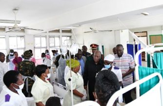 Tanzanian President John Pombe Magufuli talks to medical staff and victims of the Morogoro petrol tanker explosion, at the Muhimbili National Hospital in Dar es Salaam, on August 11, 2019. - Tanzania was in mourning on August 11, 2019, preparing to bury 69 people who perished when a crashed fuel tanker exploded as crowds rushed to syphon off leaking petrol. The deadly blast, which took place on August 10, 2019 near the town of Morogoro, west of the economic capital Dar es Salaam, is the latest in a series of similar disasters in Africa. (Photo by STRINGER / AFP)