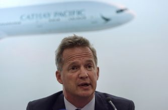 (FILES) This file photo taken on August 16, 2017 shows Cathay Pacific's chief executive officer Rupert Hogg speaking during a press conference on the company's half-year results in Hong Kong. - Cathay Pacific announced the shock resignation on August 16, 2019 of its CEO Rupert Hogg, days after the Hong Kong carrier was censured by Beijing because some staff had supported pro-democracy protests in the city. (Photo by Anthony WALLACE / AFP)