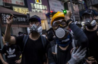 An anti-government use laser pens to point at police during a protest in the Mong kok district of Hong Kong on August 17, 2019, in the latest opposition to a planned extradition law that has since morphed into a wider call for democratic rights in the semi-autonomous city. - Hong Kong democracy activists kicked off a weekend of fresh rallies on August 17 in a major test for the movement following criticism over an airport protest earlier this week -- and as concerns mount over Beijing's next move. (Photo by ISAAC LAWRENCE / AFP)