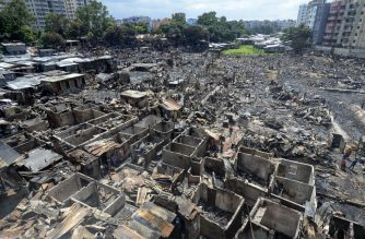 A general view of the slum in Dhaka on August 18, 2019, after a fire broke out late on August 17 at Mirpur neighbourhood. - At least 10,000 people are homeless after a massive fire swept through a crowded slum in the Bangladesh capital and destroyed thousands of shanties, officials said on August 18. (Photo by MUNIR UZ ZAMAN / AFP)