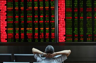 FILES: A Investor looks at screens showing stock market movements at a securities company in Beijing on August 26, 2019. - Asian equity markets tanked and the yuan hit an 11-year low Monday after US President Donald Trump ramped up his trade war with China by hiking tariffs on more than half-a-trillion dollars worth of imports. (Photo by WANG Zhao / AFP)