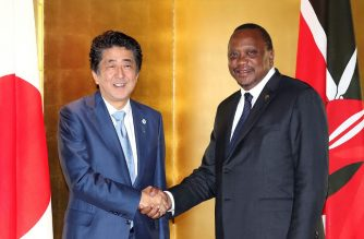 Japan's Prime Minister Shinzo Abe (L) shakes hands with Kenya's President Uhuru Kenyatta (R) during their bilateral meeting on the sidelines of the Tokyo International Conference on African Development (TICAD) in Yokohama on August 28, 2019. (Photo by JAPAN POOL VIA JIJI PRESS / JIJI PRESS / AFP) / Japan OUT