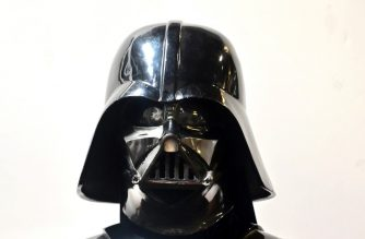 "A Darth Vader helmet and mask from the film ""The Empire Strikes Back"" on display at the Profiles in History auction house on August 28, 2019 in Calabasas, California ahead of ""The Icons and Legends of Hollywood Auction"" on September 25 and 26. - Darth Vader's helmet from ""The Empire Strikes Back"" is among a vast collection of coveted Hollywood treasures going under the hammer next month, with experts predicting it could fetch nearly half-a-million dollars. (Photo by Frederic J. BROWN / AFP)"