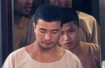 Myanmar prisoners Zaw Lin (C) and Win Zaw Tun (R) leave the court in Nonthaburi after the verdict on August 29, 2019. - Thailand's top court upheld the death sentence against two Myanmar migrant workers on August 29 in a final appeal against their conviction of murdering two British backpackers on a holiday island in a case tainted by allegations of mismanagement. (Photo by Mladen ANTONOV / AFP)