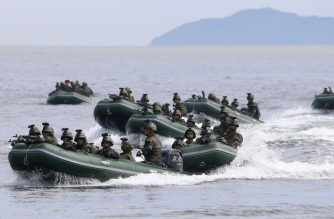 """This undated photo released by North Korea's official Korean Central News Agency (KCNA) on August 26, 2017 shows special operation forces personnel of the Korean People's Army (KPA) conducting a target strike exercise at an undisclosed location in North Korea. - North Korea fired three short-range ballistic missiles on August 26, the US military said, following weeks of heightened tensions between Washington and Pyongyang. (Photo by STR / KCNA via KNS / AFP) / South Korea OUT / REPUBLIC OF KOREA OUT   ---EDITORS NOTE--- RESTRICTED TO EDITORIAL USE - MANDATORY CREDIT """"AFP PHOTO/KCNA VIA KNS"""" - NO MARKETING NO ADVERTISING CAMPAIGNS - DISTRIBUTED AS A SERVICE TO CLIENTS THIS PICTURE WAS MADE AVAILABLE BY A THIRD PARTY. AFP CAN NOT INDEPENDENTLY VERIFY THE AUTHENTICITY, LOCATION, DATE AND CONTENT OF THIS IMAGE. THIS PHOTO IS DISTRIBUTED EXACTLY AS RECEIVED BY AFP. /"""