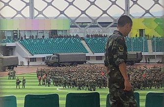 Chinese military personnel gather at the Shenzhen Bay stadium in Shenzhen, bordering Hong Kong in China's southern Guangdong province, on August 15, 2019. (Photo by STR / AFP)